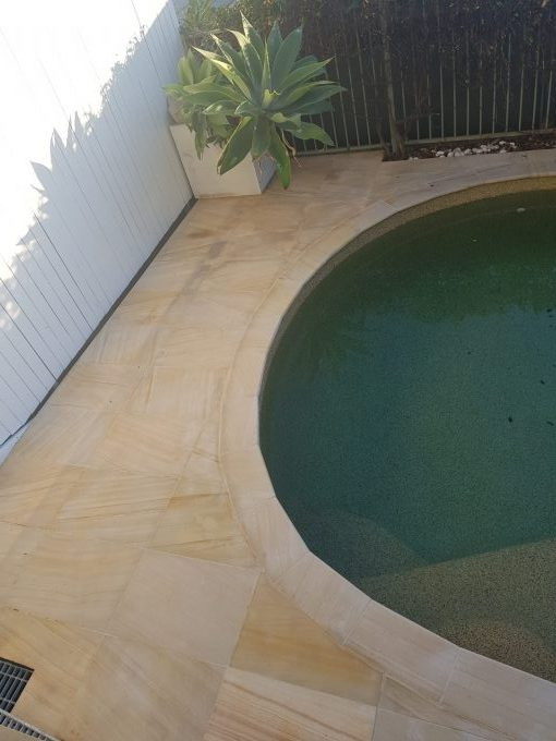 sandstone pavers around pool